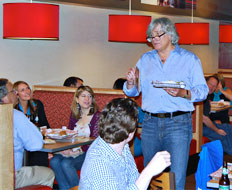 Smashburger cofounder Tom Ryan explains a craft beer and burger pairing at a recent Chicago event.